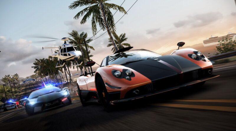 a imagem mostra dois carros, um sendo uma viatura perseguindo uma mclaren em Hot Pursuit